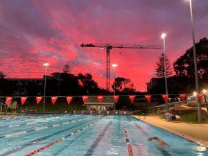Person swimming at Claremont Aquatic Centre at dawn